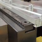 Image - Long Serrated Grips Maintain Contact on Full-Length of Workpiece